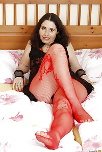 Grandma at red fishnet and her hairy old pussy